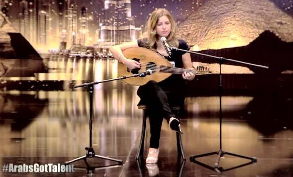 Jennifer Grauta singing song in a contest program
